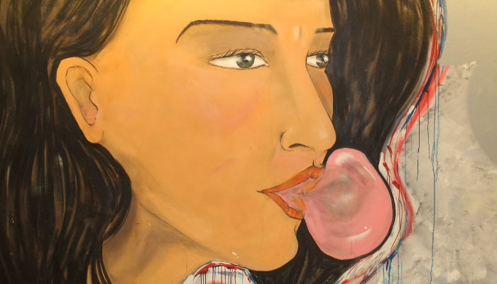 mural of woman blowing gum bubble