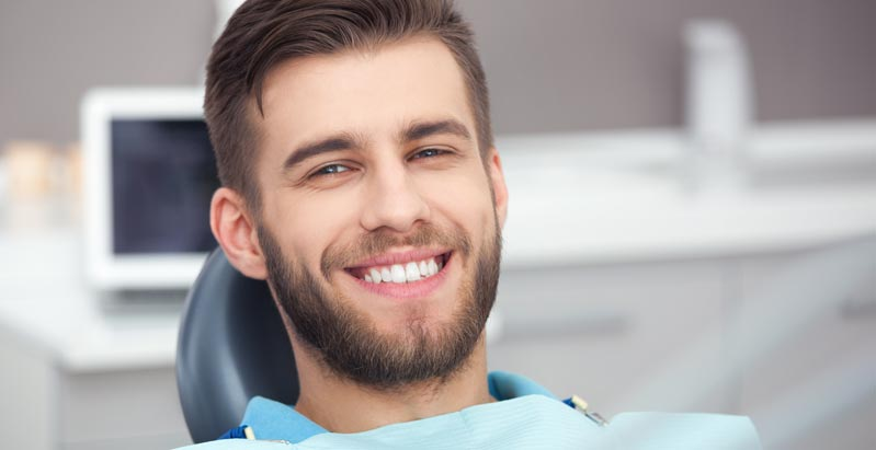 young man in dental office